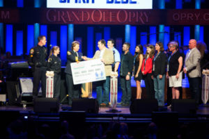 Spirit of Blue Presents Grant to Franklin Police Department on Grand Ole Opry Stage